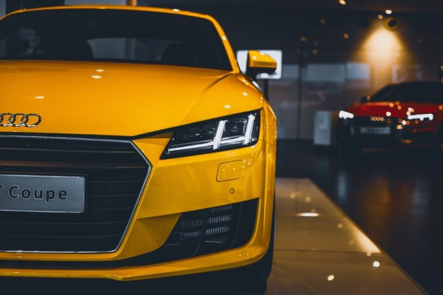 Audi Coupe is yellow, loks like a race car but its a sports car. The article is about driverless and self driving cars.