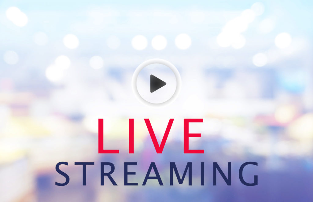 blurred background with words that read live streaming, with a play arrow icon.