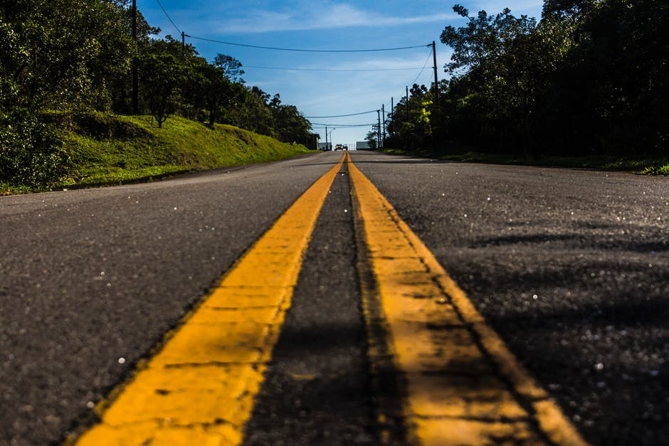 asphalt road with speed stripe during covid id. article is about teleoperation